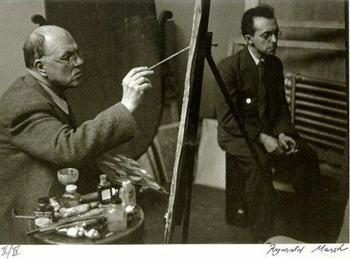 Edward Hopper painting at his easel with Raphael Soyer